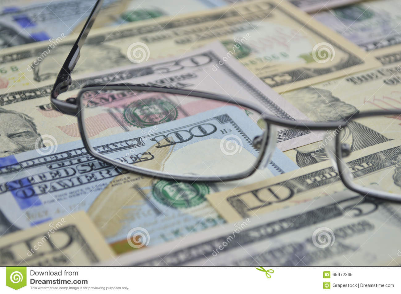 Glasses and dollar bank note money; financial background