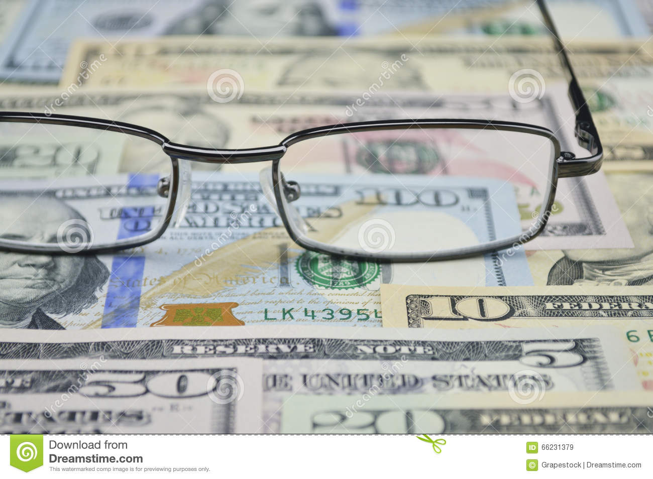 Glasses on dollar money, financial concept