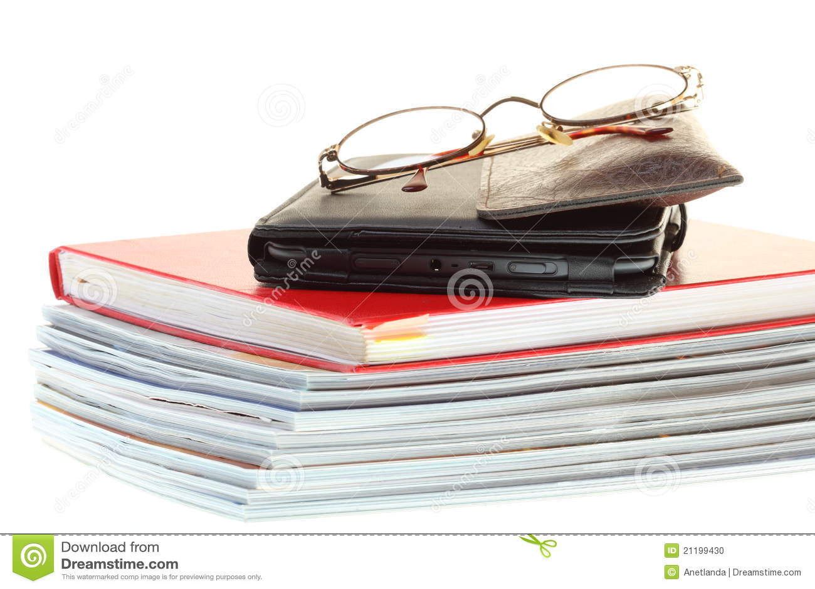 Glasses eBook reader pile of books