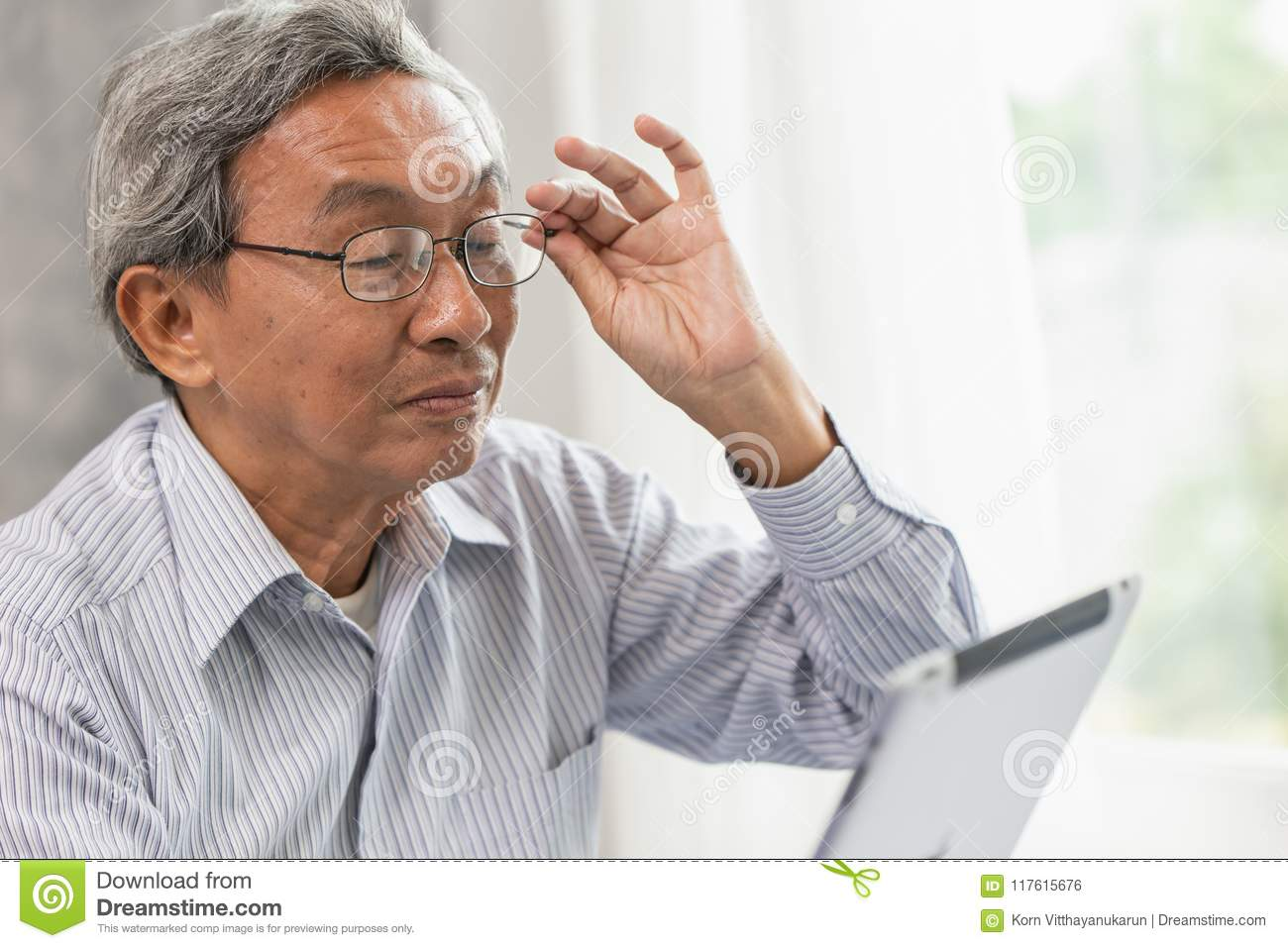 glasses elderly old man happy using looking at Tablet screen