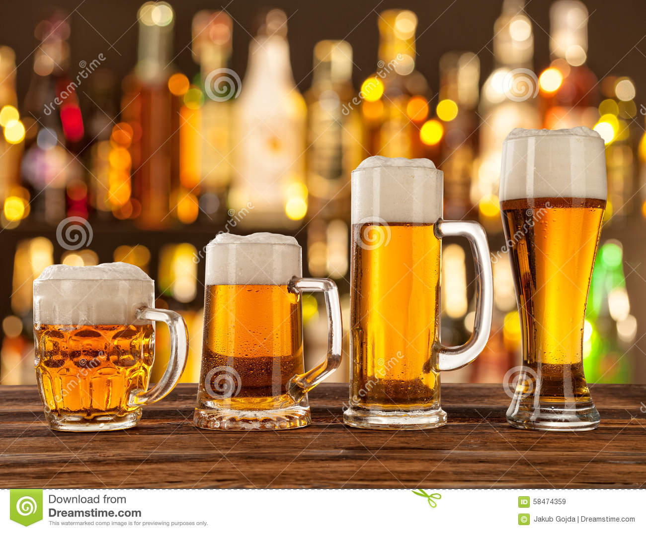 glasses of light beer with bar on background stock image