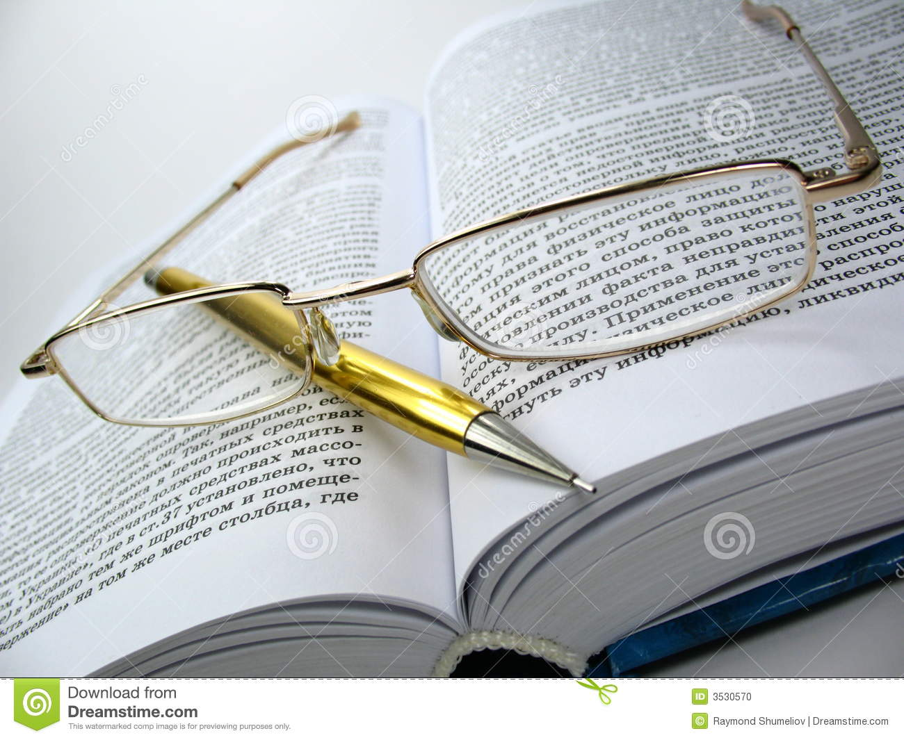 glasses on book - photo #19