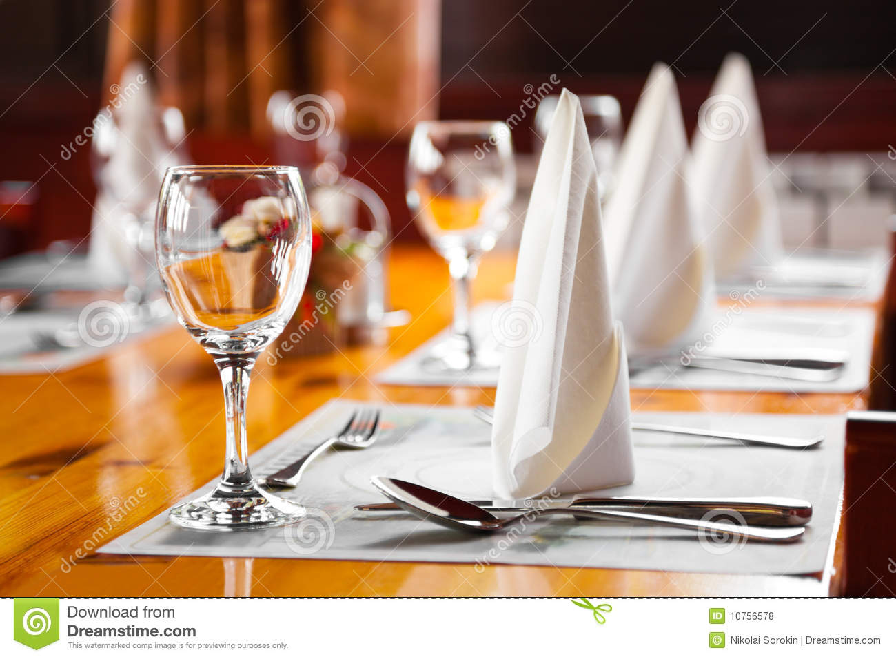 Glasses and plates on table in restaurant stock photo for Restaurant table menu