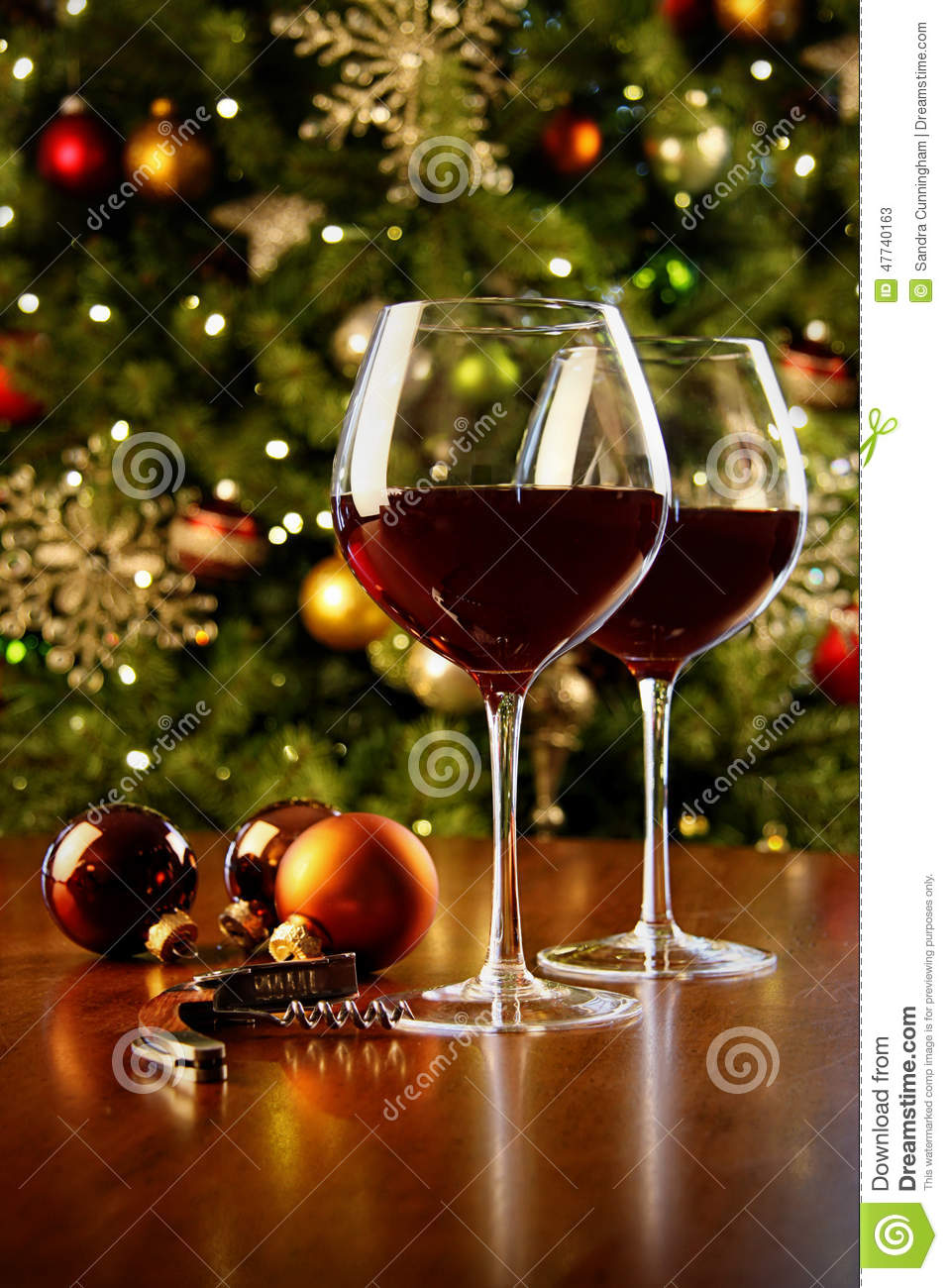 Glasses Of Red Wine On Table With Christmas Tree Stock ...