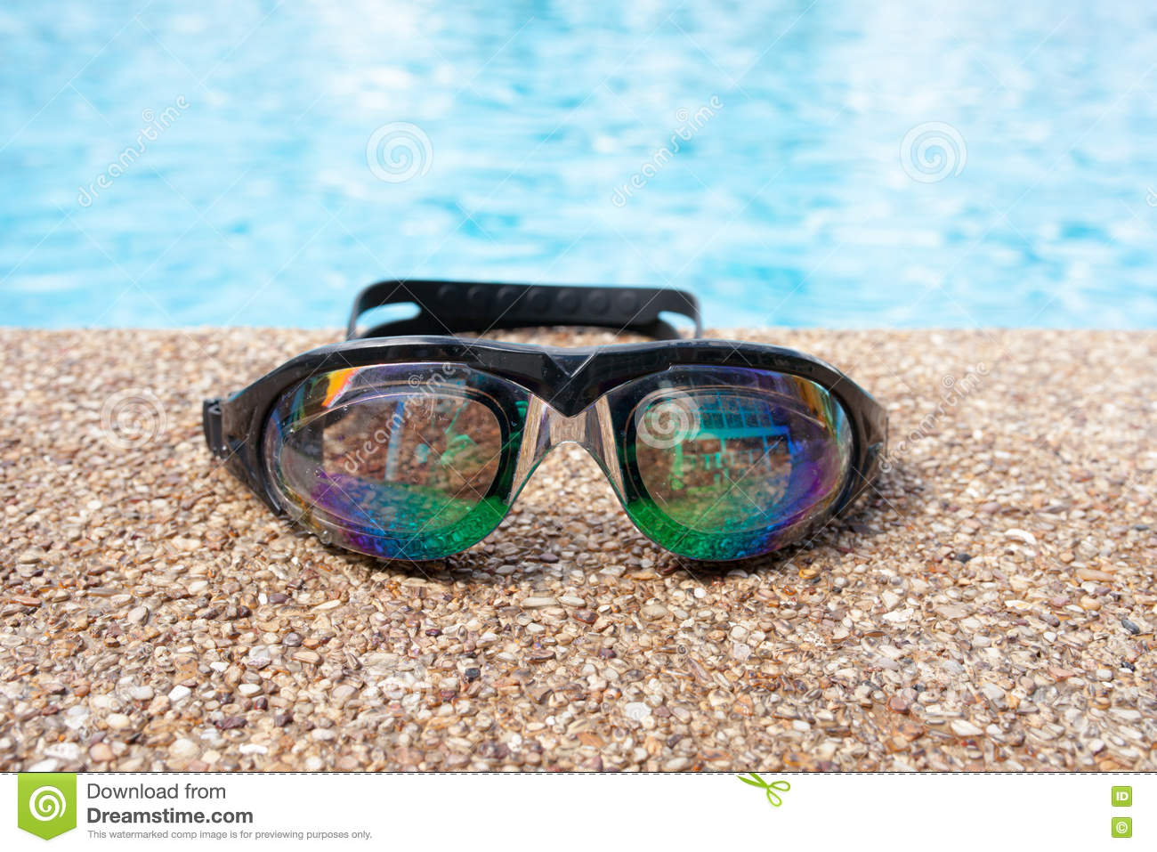 Glasses For Swimming On A Cement Floor With Small Stone Near Swimming Pool Stock Photo Image