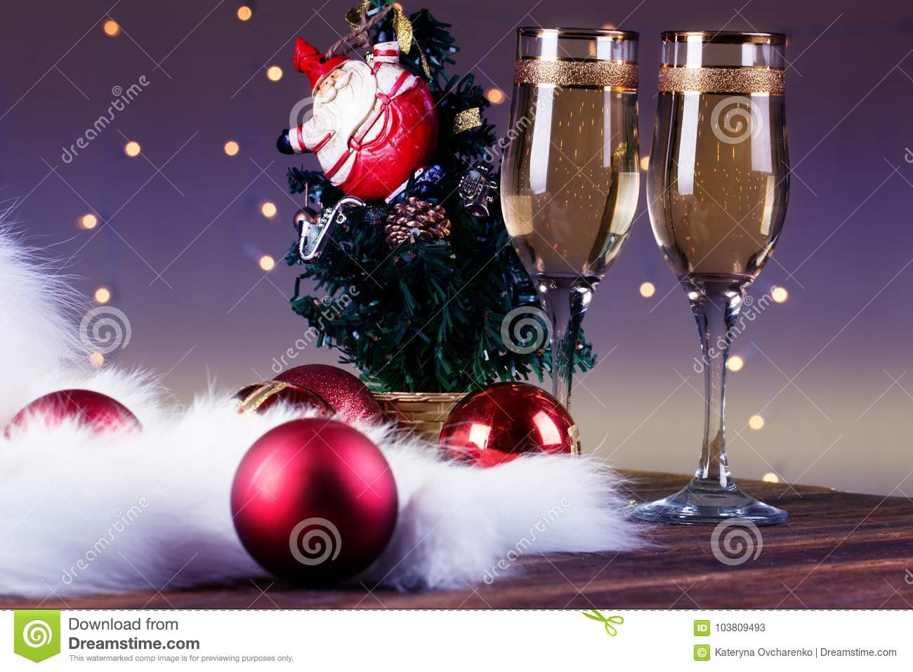 glasses of wine on the background of christmas decorations christmas decorations with wineglass toasting with champagne glasses