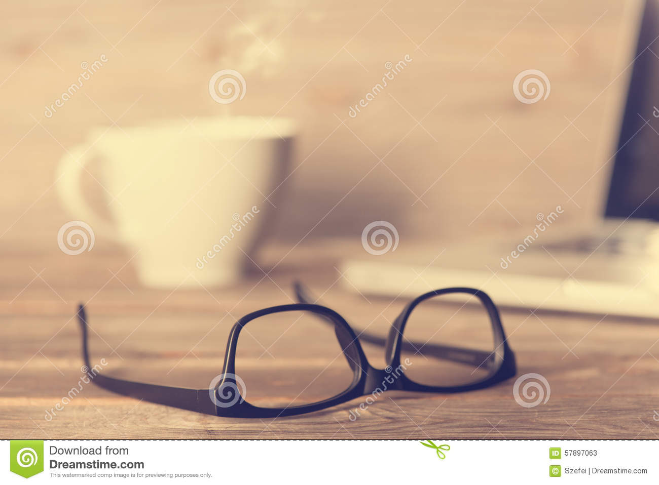 Glasses on wooden work table