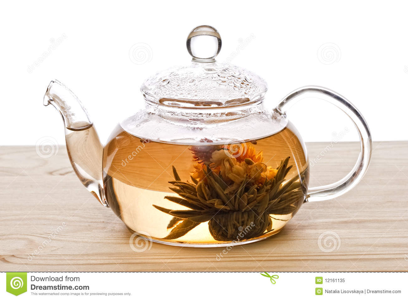 Chinese flower tea - Glassy Teapot With Lotus Flower Chinese Tea Royalty Free Stock Photo