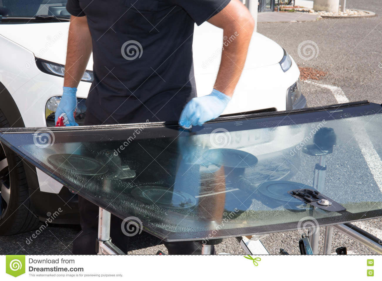 Glazier Removing Windshield Or Windscreen On A Car Stock Image ...