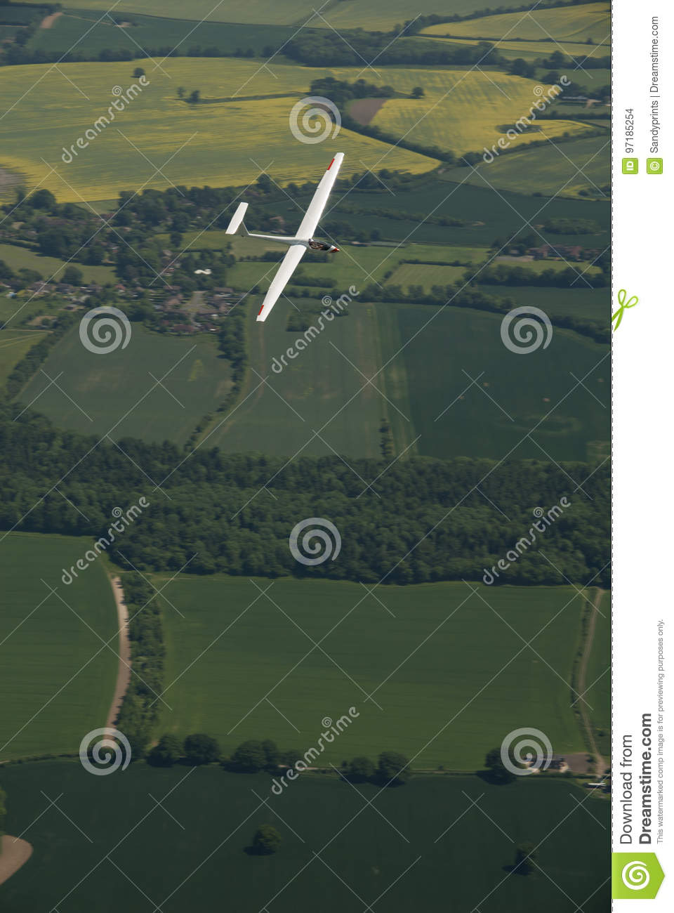 glider sailplane flying over countryside stock photo image of
