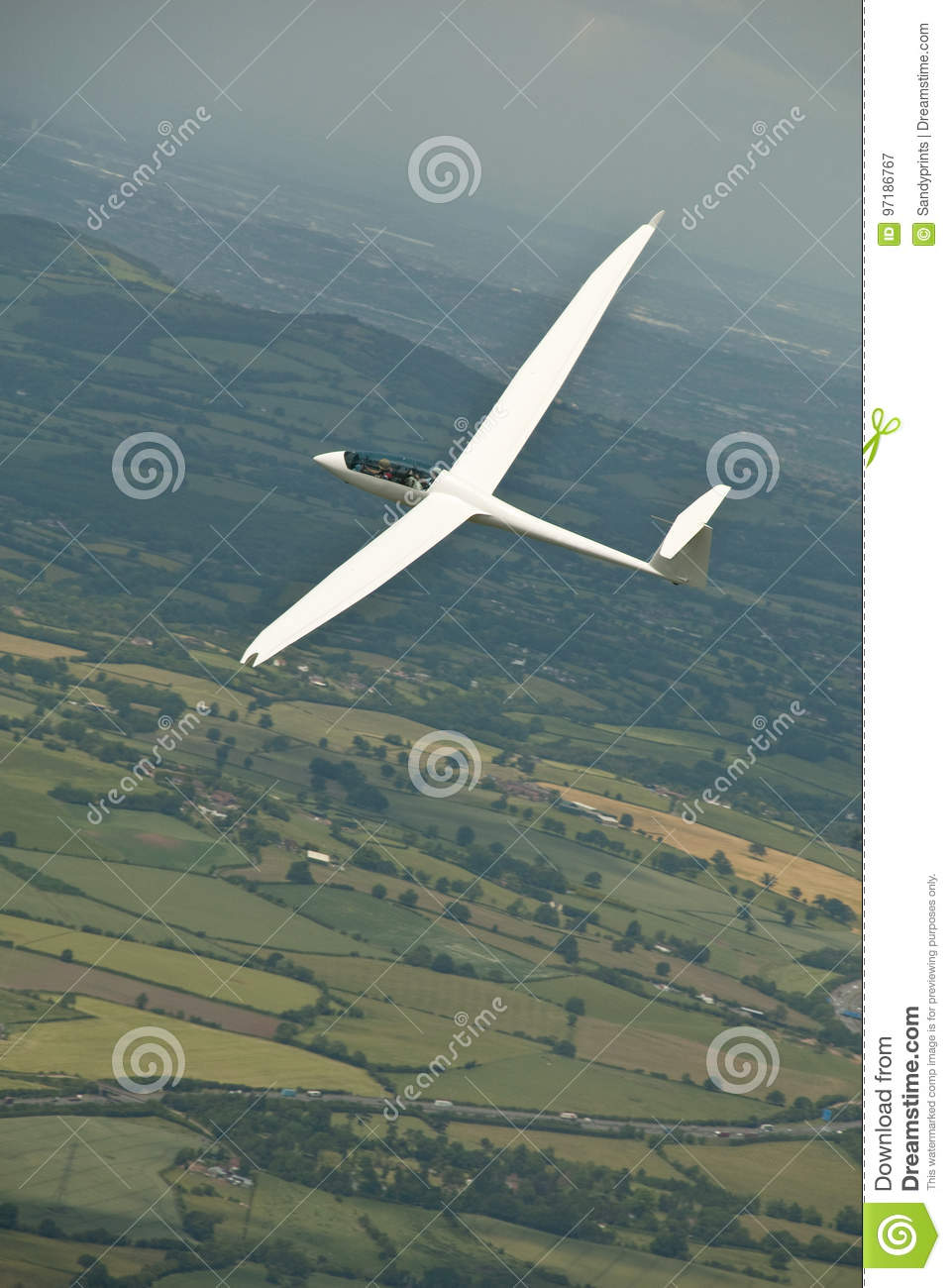 glider sailplane flying over countryside stock image image of