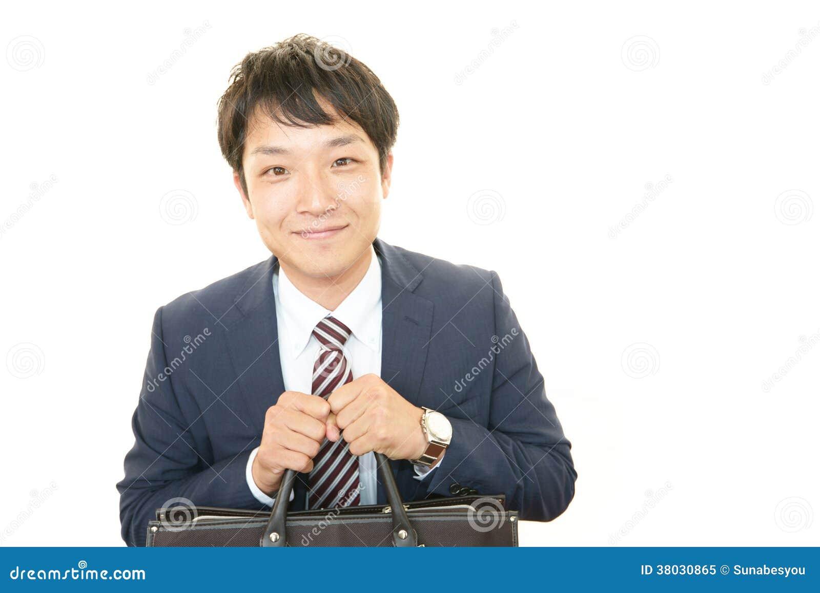 Glimlachende Aziatische zakenman