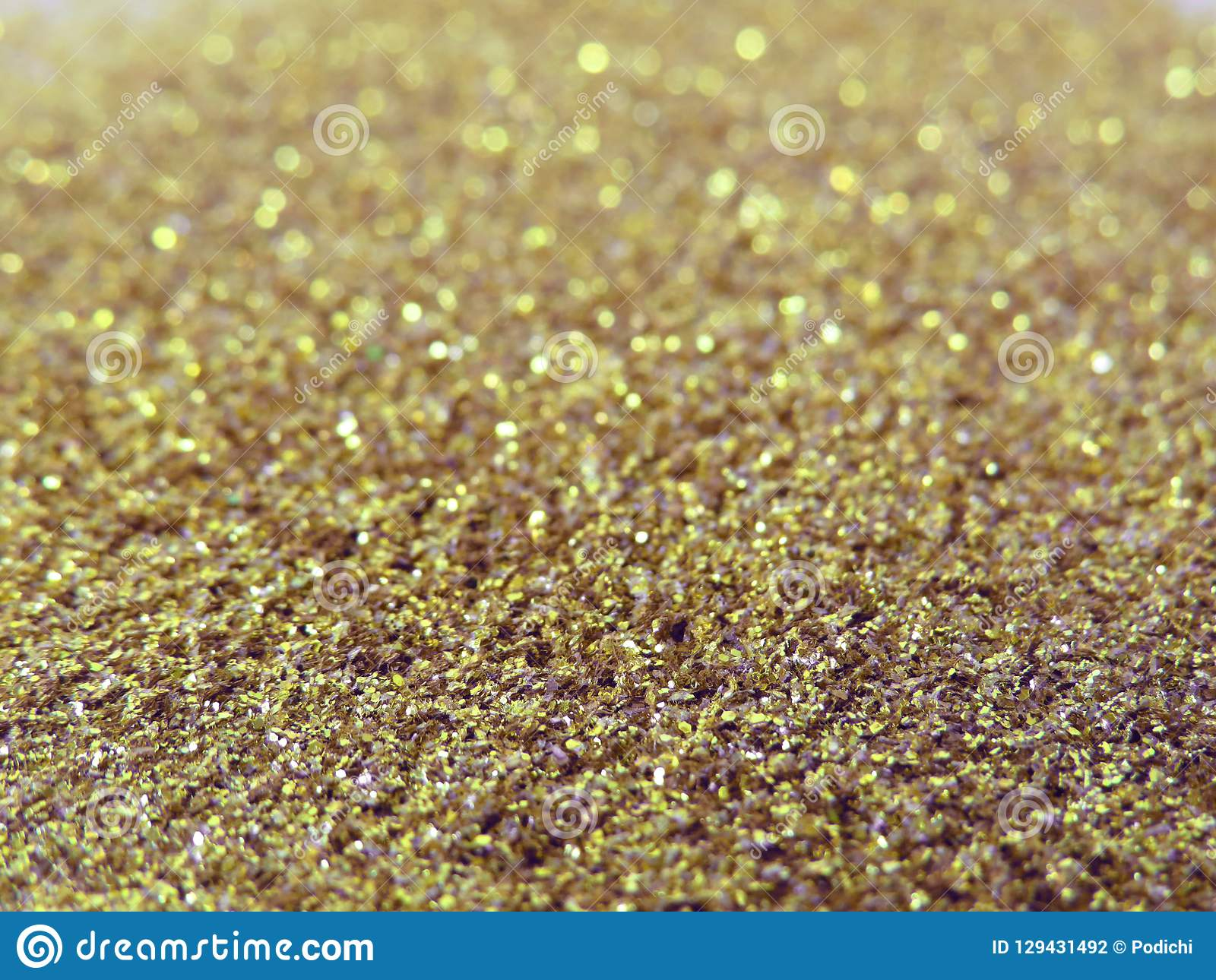 Glitter gold dust and sand background for christmas greeting cards