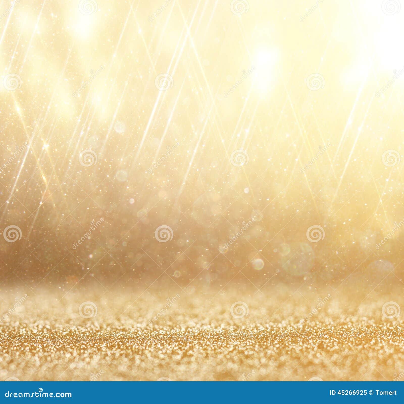 Glitter vintage lights background. abstract gold background . defocused