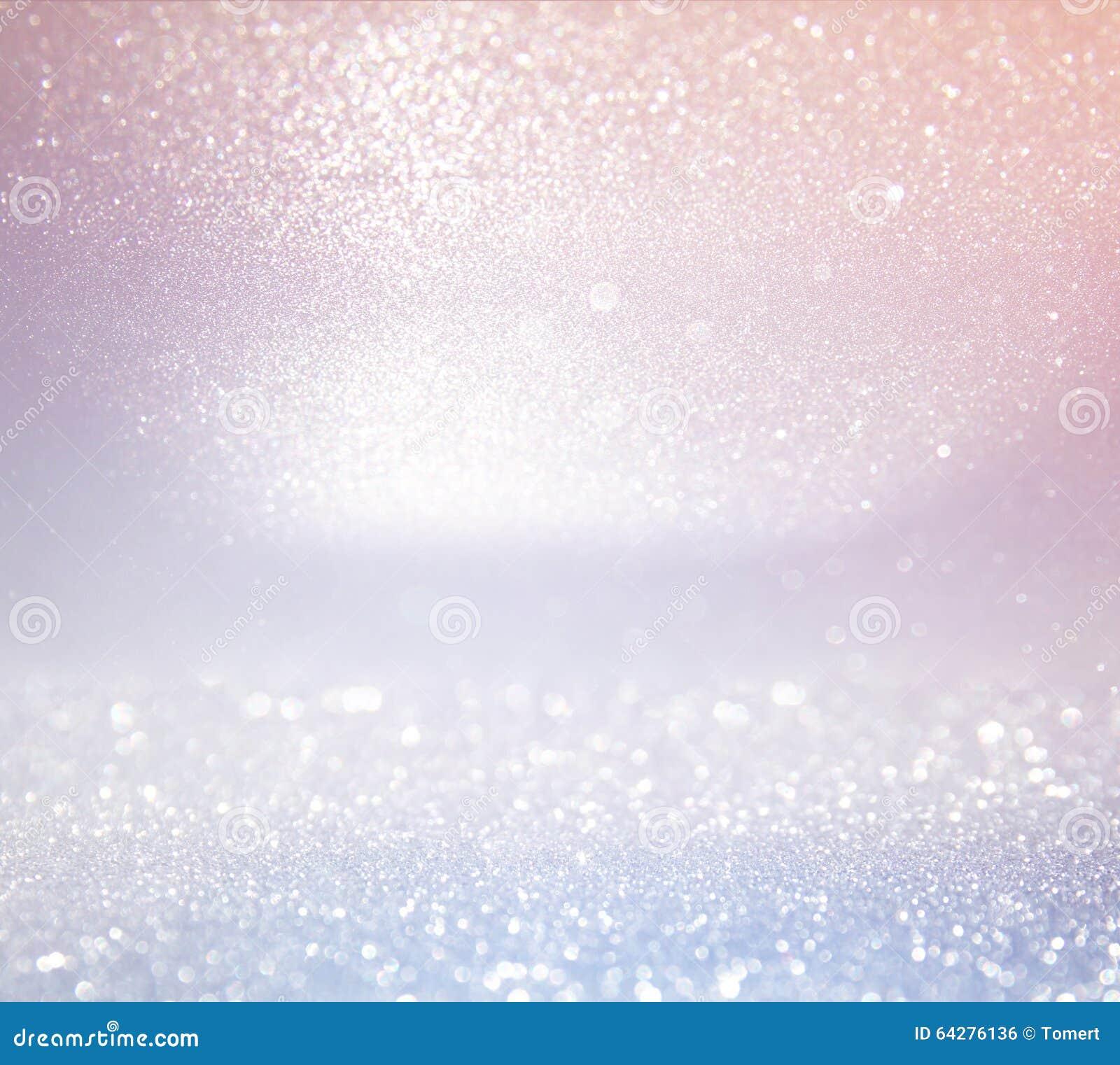 Glitter vintage lights background. light silver, and pink. defocused.