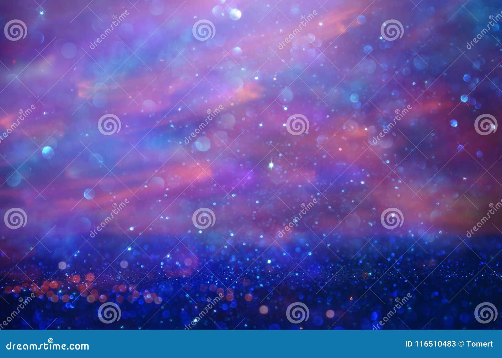 Glitter vintage lights background. pink and purple. de-focused.