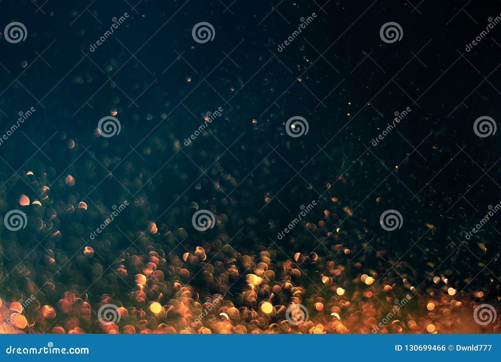 Glittering sparkles in dark