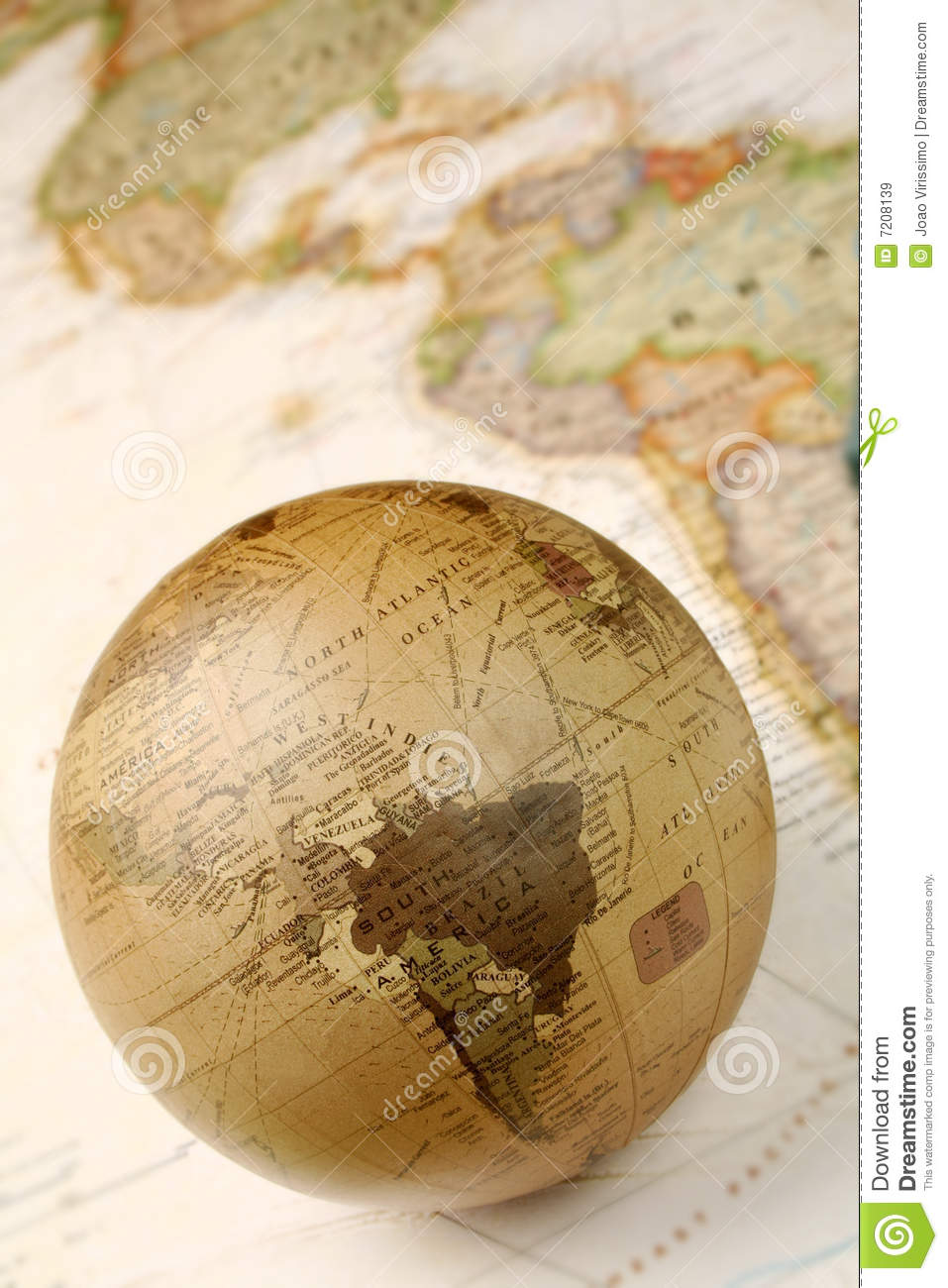 Globe over world map