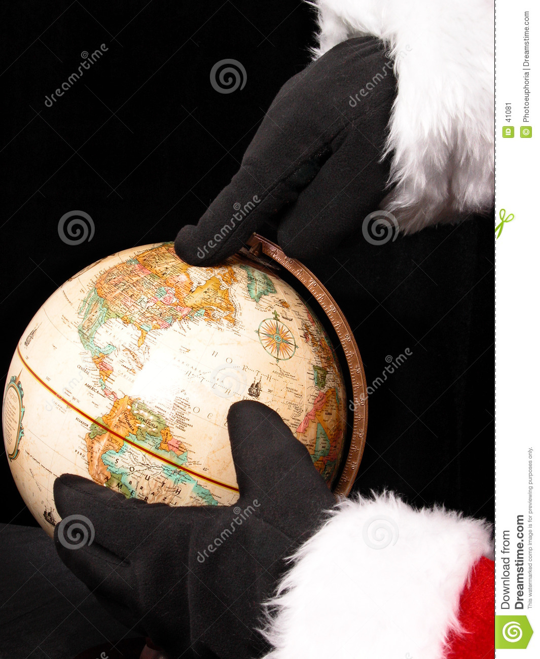 Globe with Santa a Hands Pointing the Way