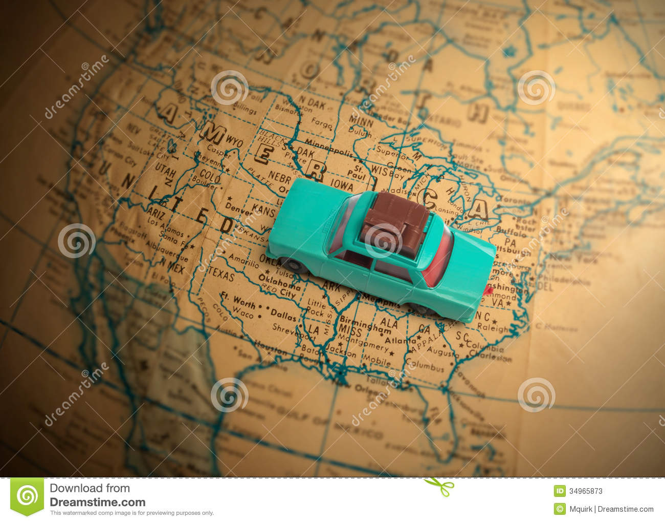 Toy car with luggage on a vintage globe map of the United States with ...