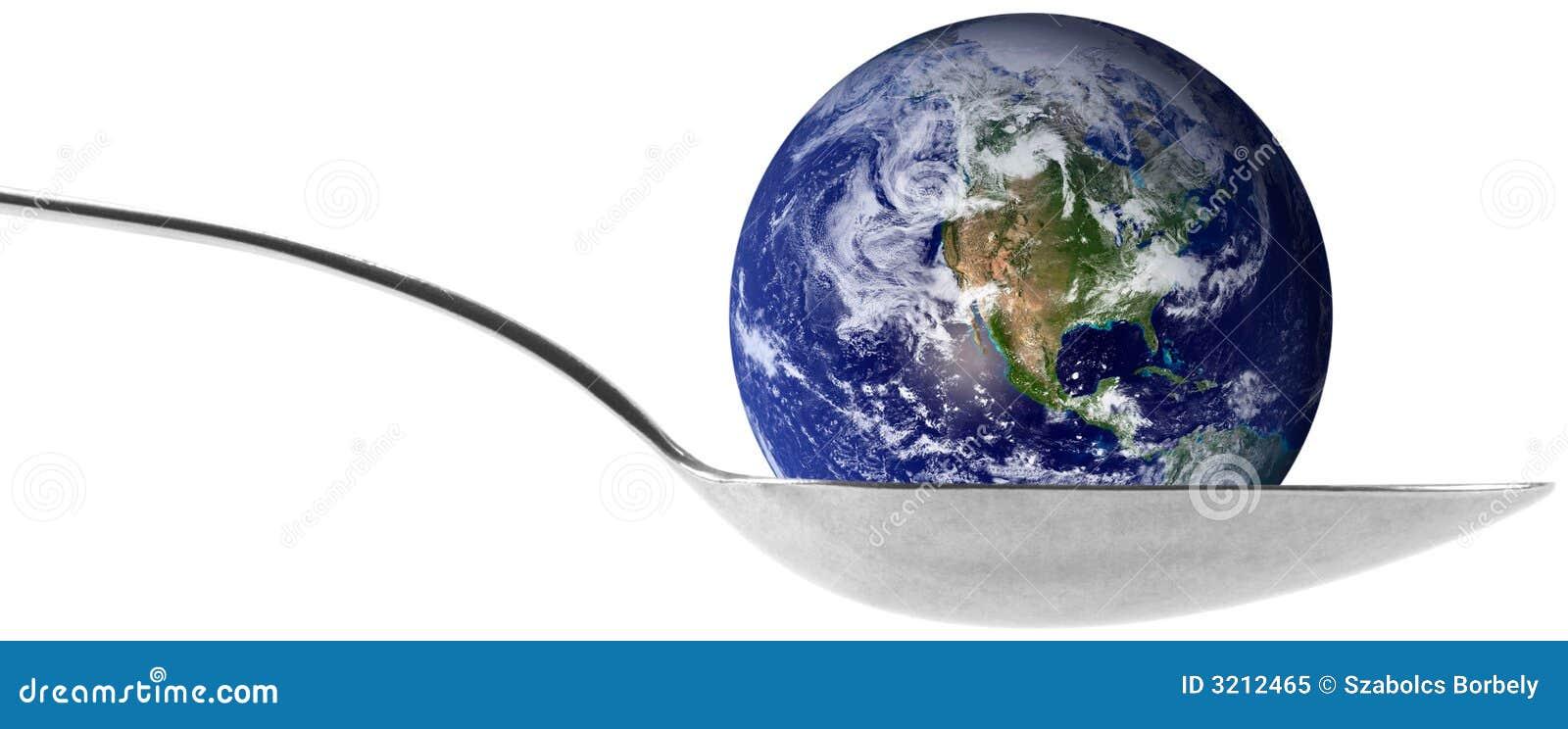 Globo da terra em uma colher