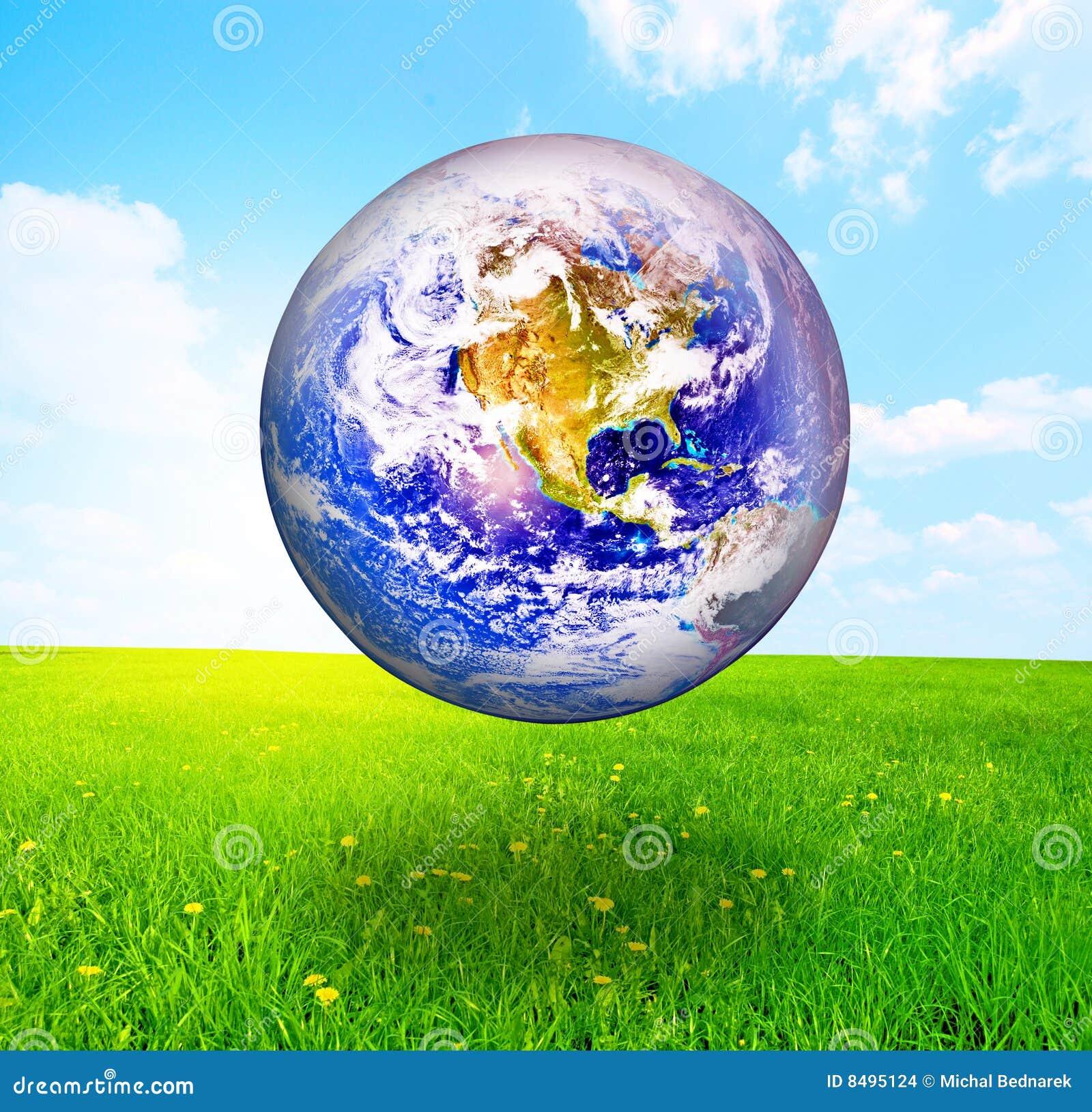 Globo de la tierra sobre paisaje hermoso
