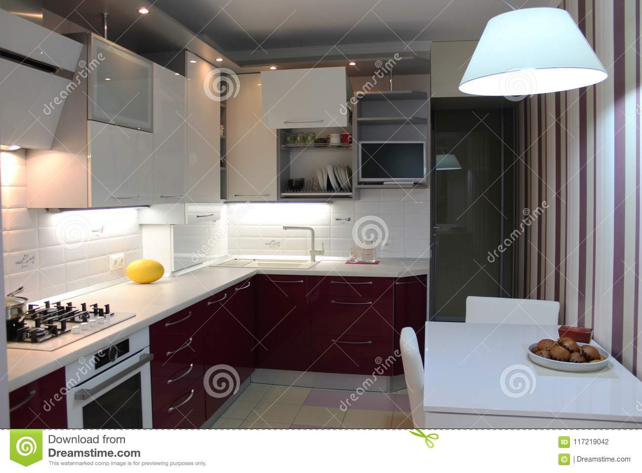 Glossy Modern Kitchen With White Top And Cherry Bottom Stock Photo