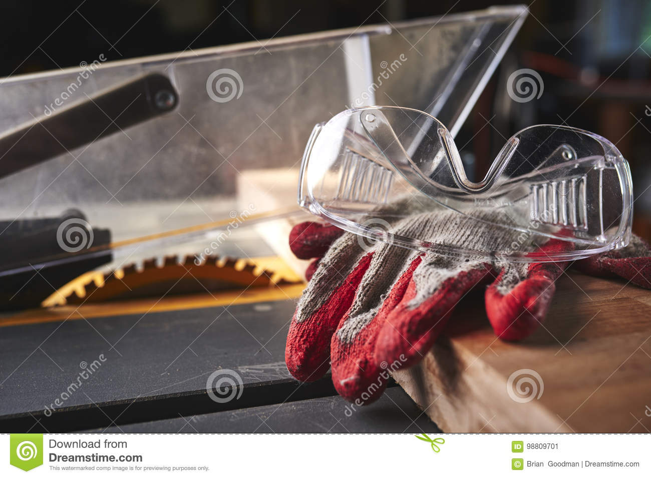 c5649f48fcc ... A carpenter s gloves and safety glasses on a table saw