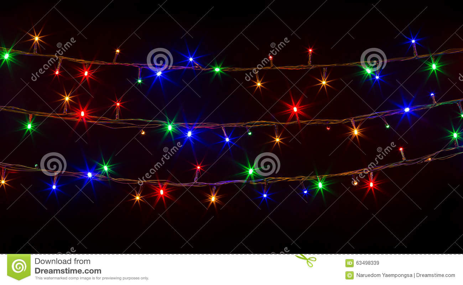Glowing christmas lights on black background stock image