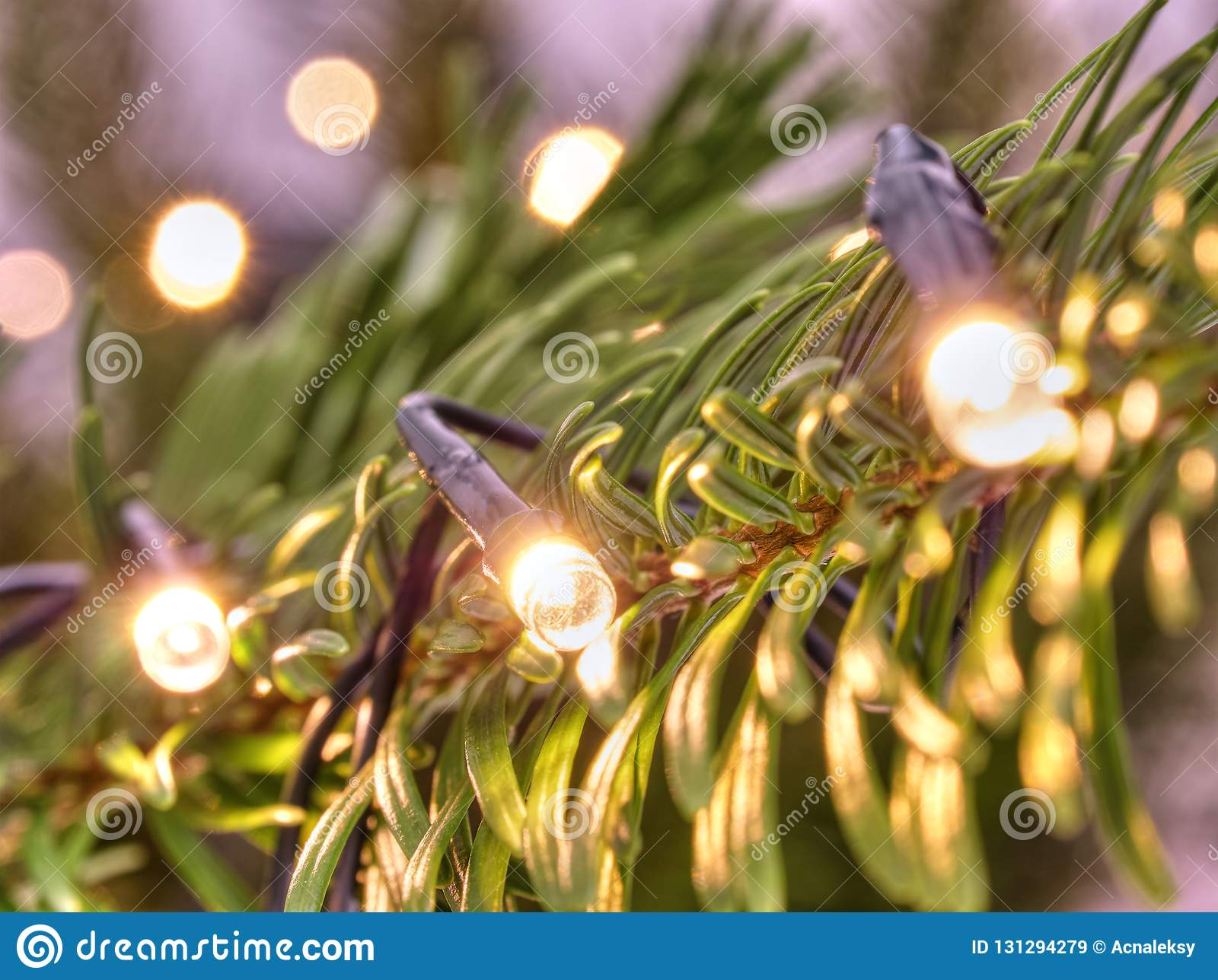 Glowing Christmas lights. Christmas tree decorated with garlands