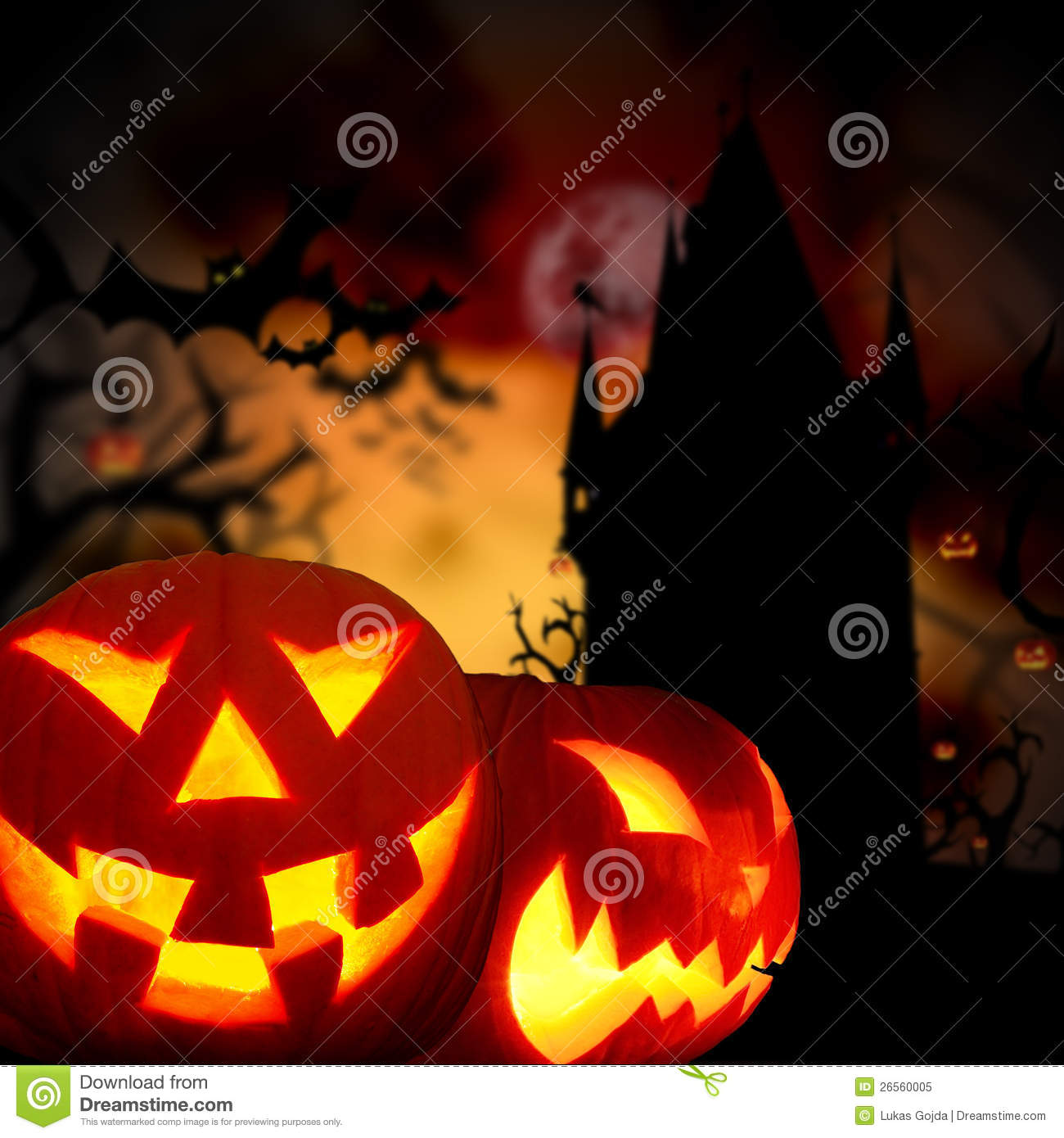 Images of glowing pumpkins in a dark scary forest with old tower