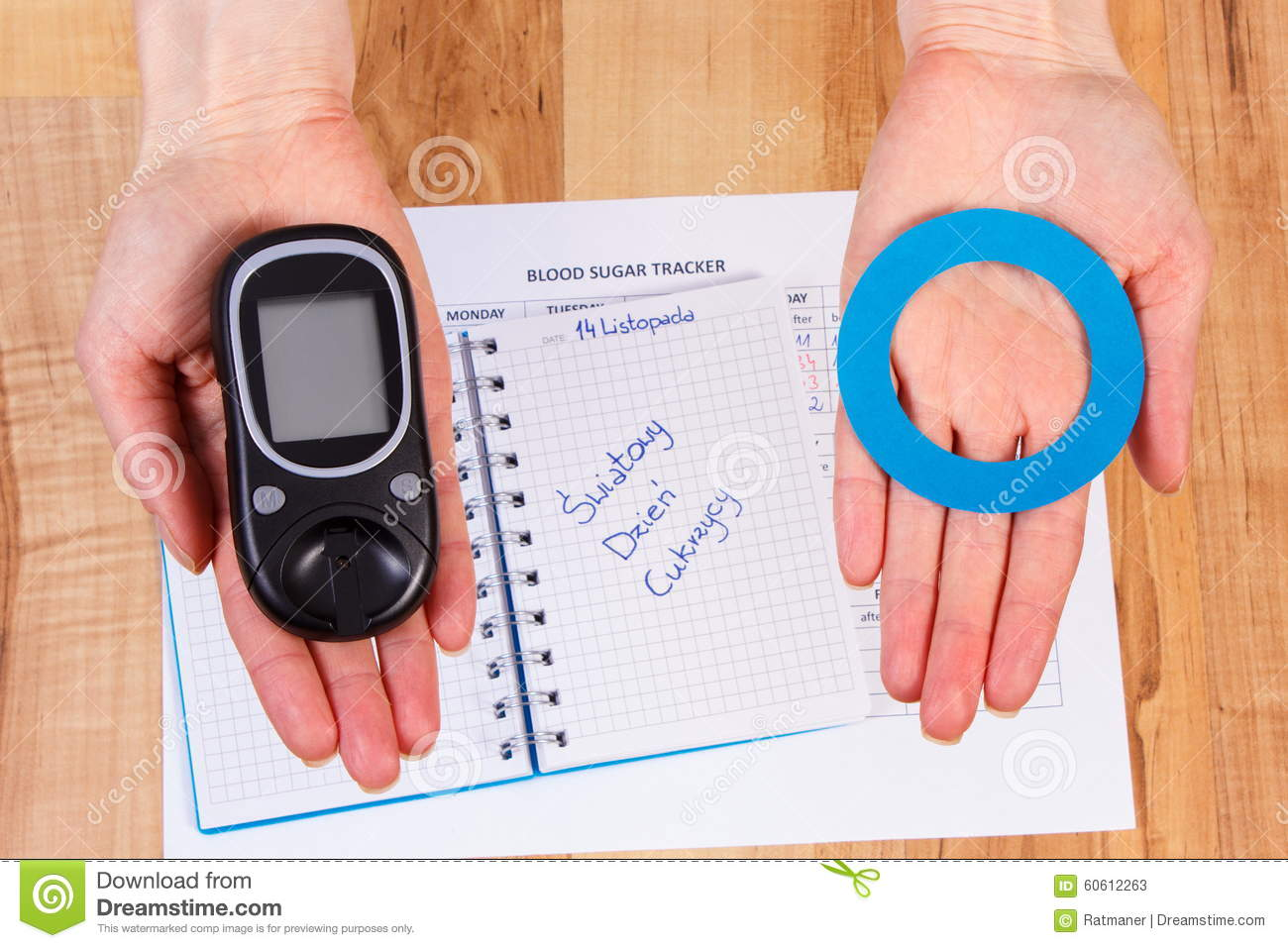 paper on diabetes paper on diabetes paper on diabetes online buy  glucometer and blue circle in hand symbol of diabetic world glucometer and blue circle in hand