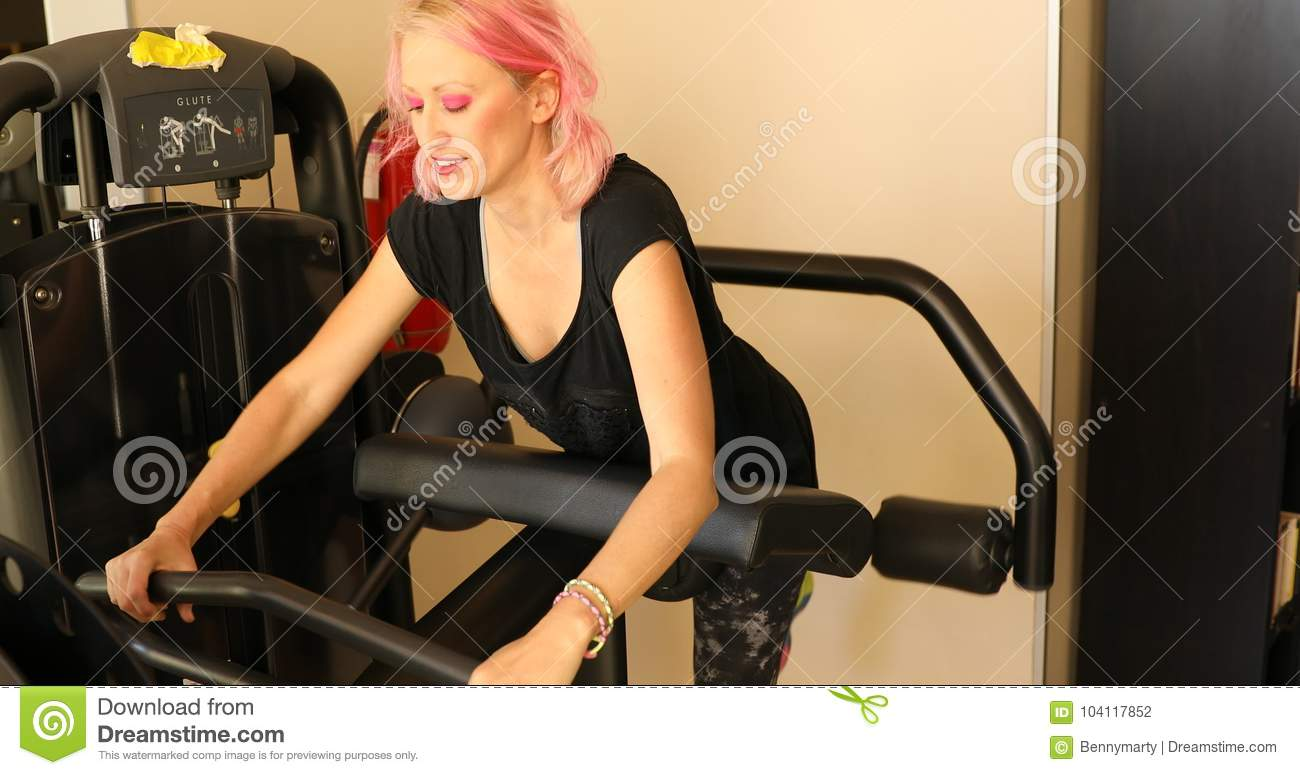 Glute Machine With Instructor Stock Photo - Image of