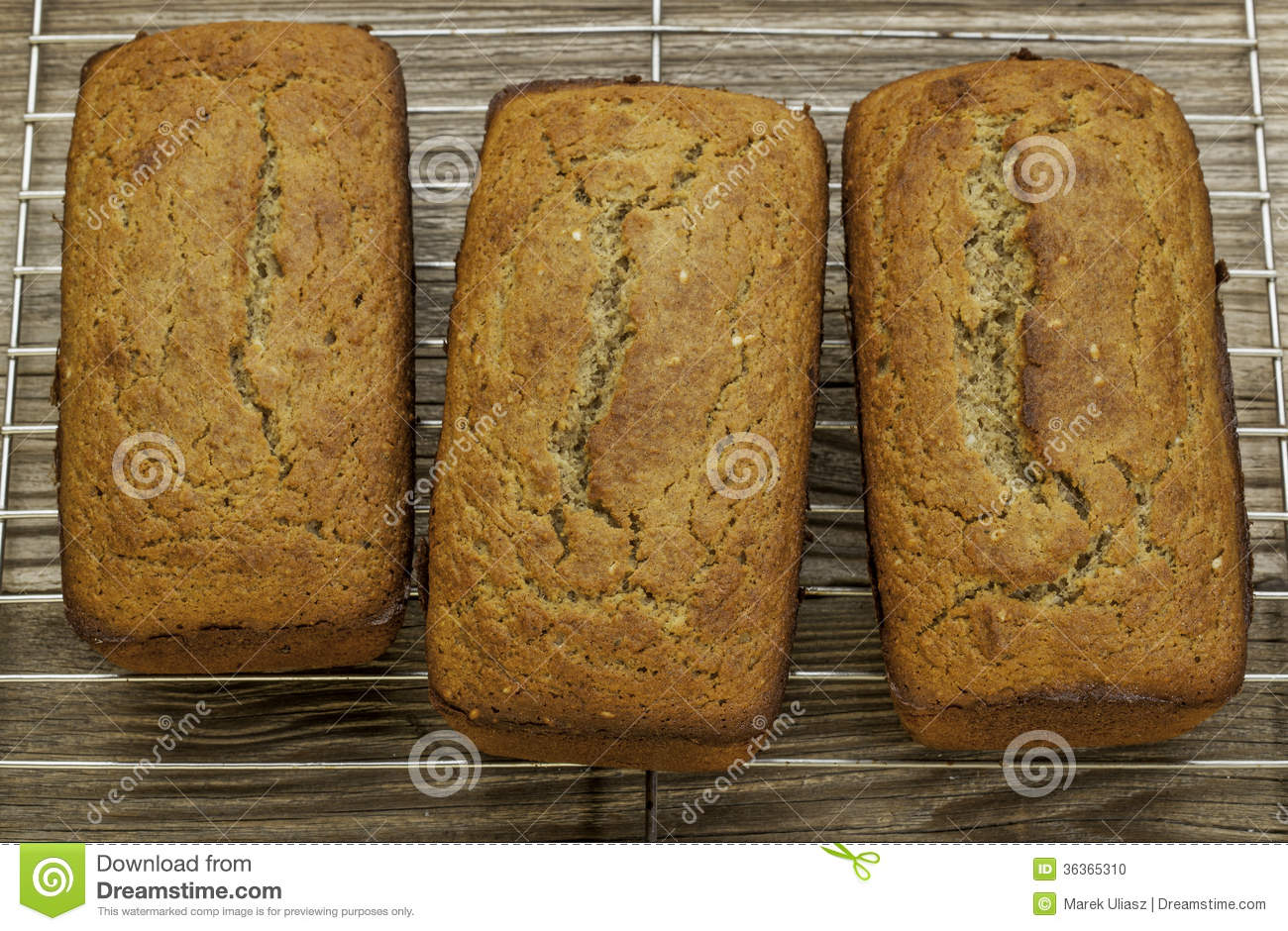 Loafs of freshly baked gluten free bread prepared with coconut and ...
