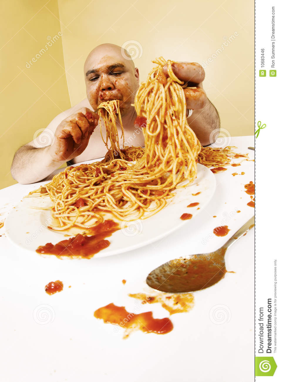 An overweight bald man enjoying a plate of spaghetti. Shot with fish ...