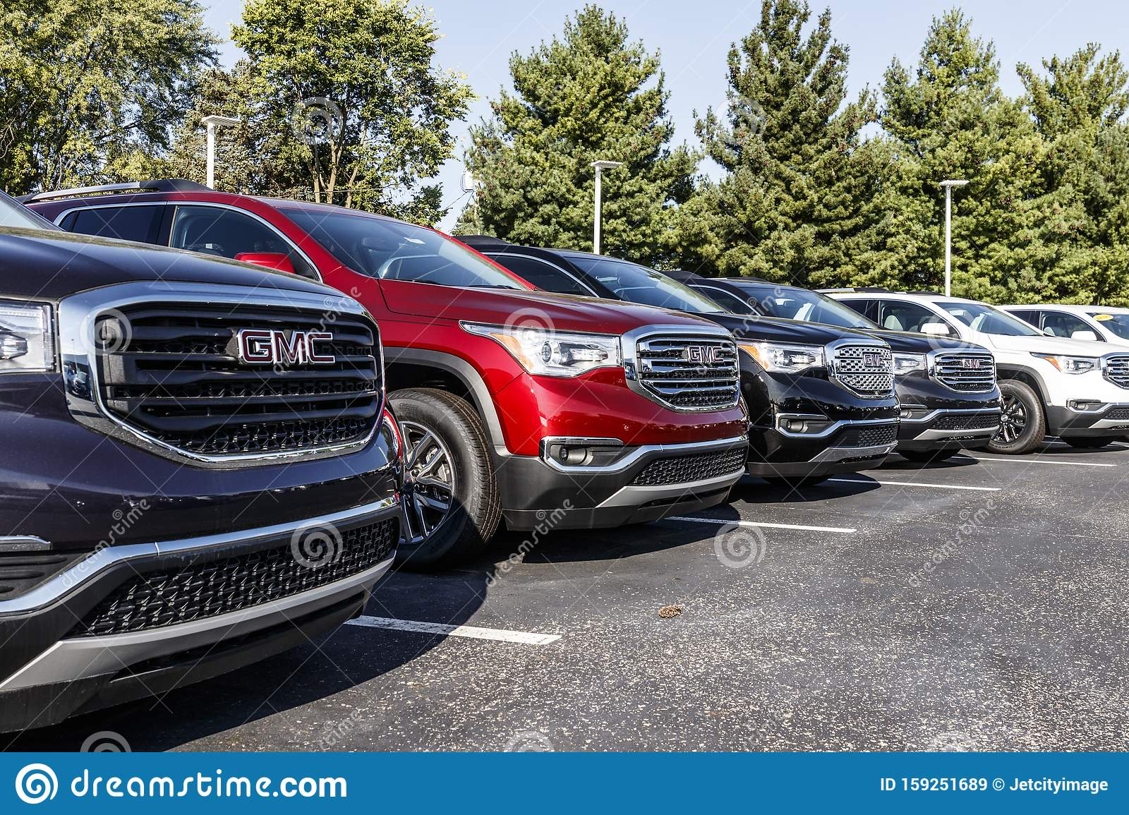 GMC SUV Display At A Buick GMC Dealership. GMC Focuses On ...