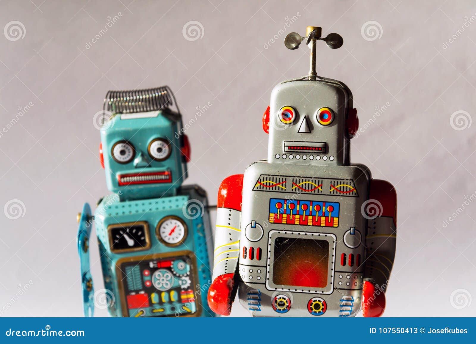 Gniewni rocznik cyny zabawki roboty, sztuczna inteligencja, mechaniczny doręczeniowy pojęcie