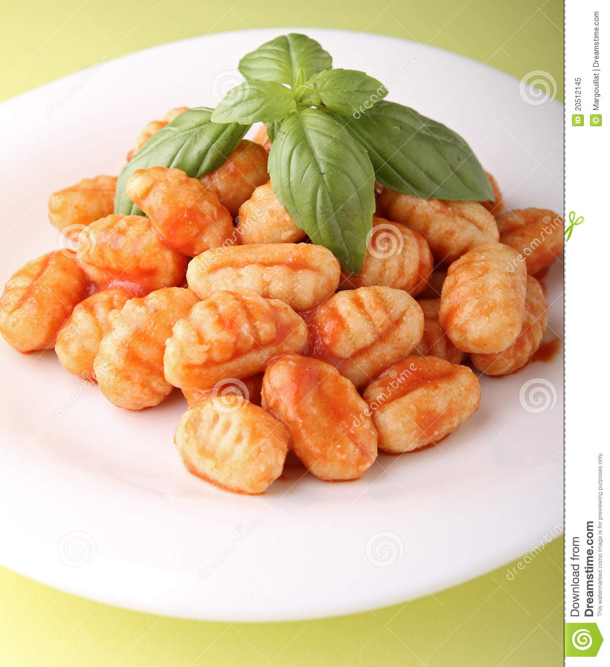 Plate of gnocchi with tomato sauce.