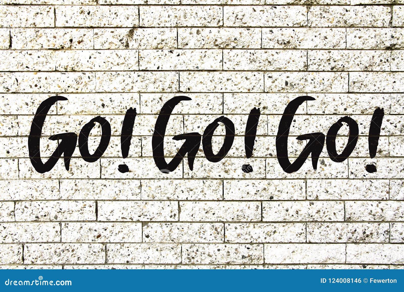 """Go! Go! Go!"" motivational text written on a white stone brick wall background"