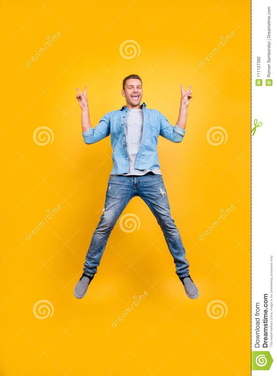 Go, mad! Glad, funny, funky guy in casual outfit full of energy