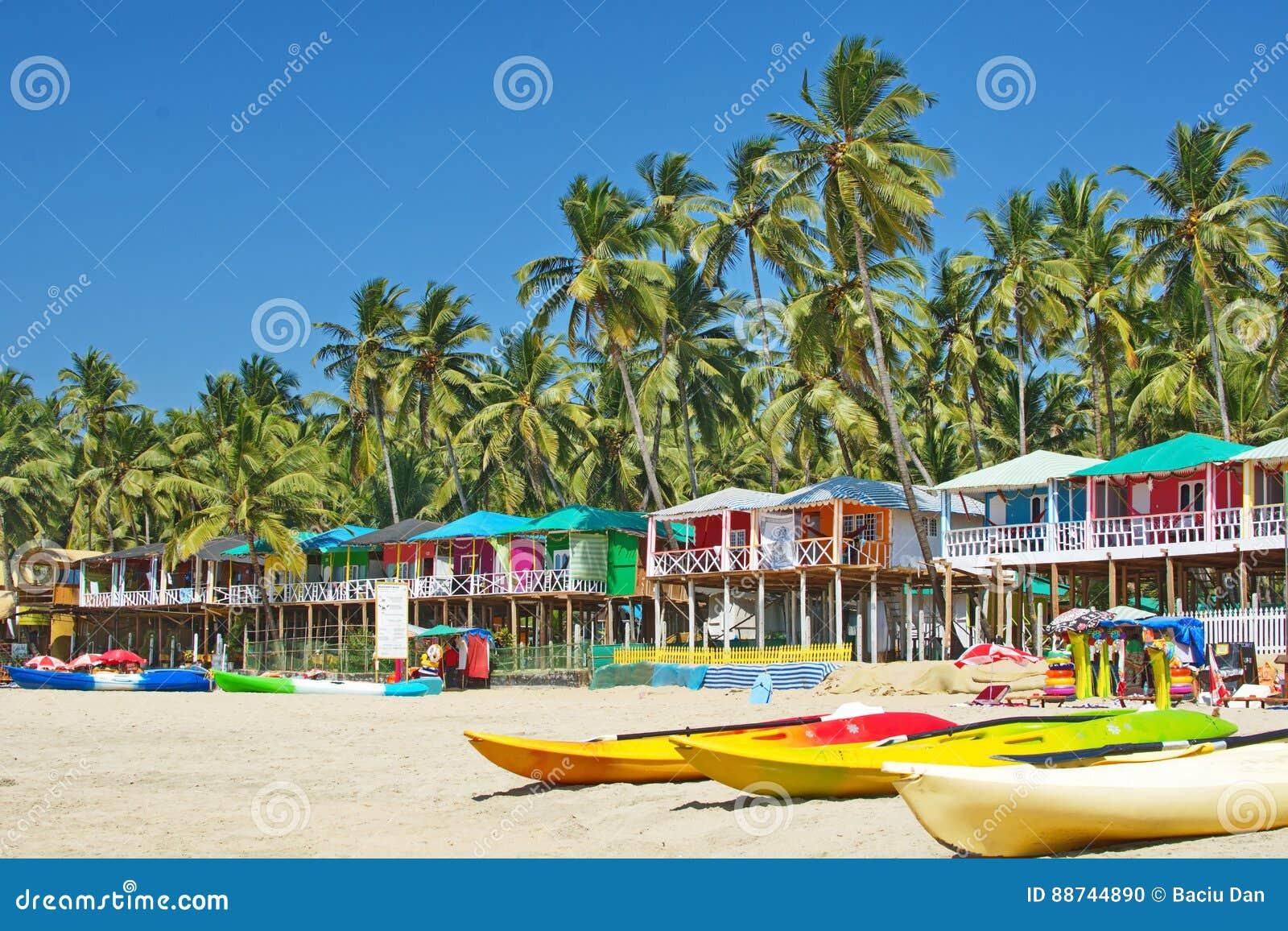 Goa beach palolem india colorful bungalows under the palm tree