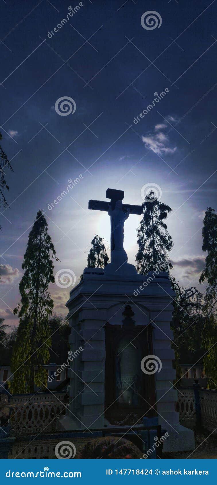 Goa divar ö, kors, Jesus, kyrka, solljus,