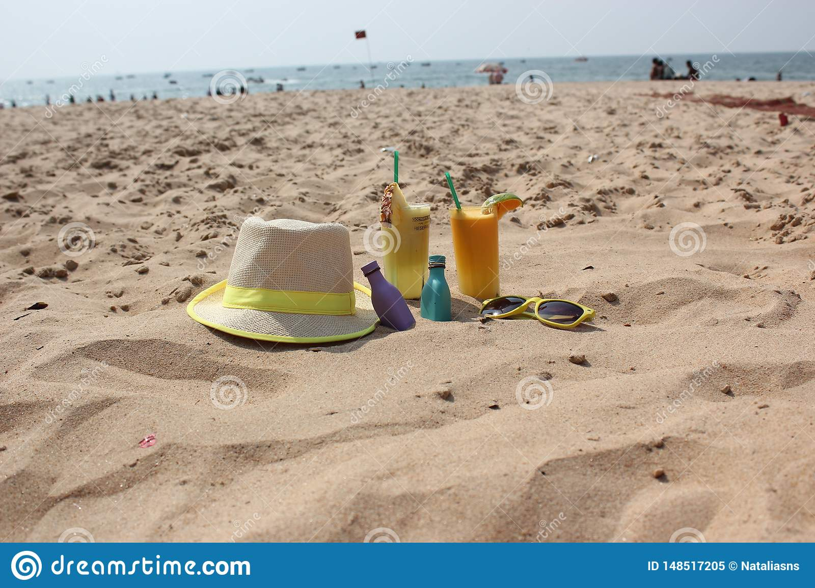 hat and cocktails on the sand