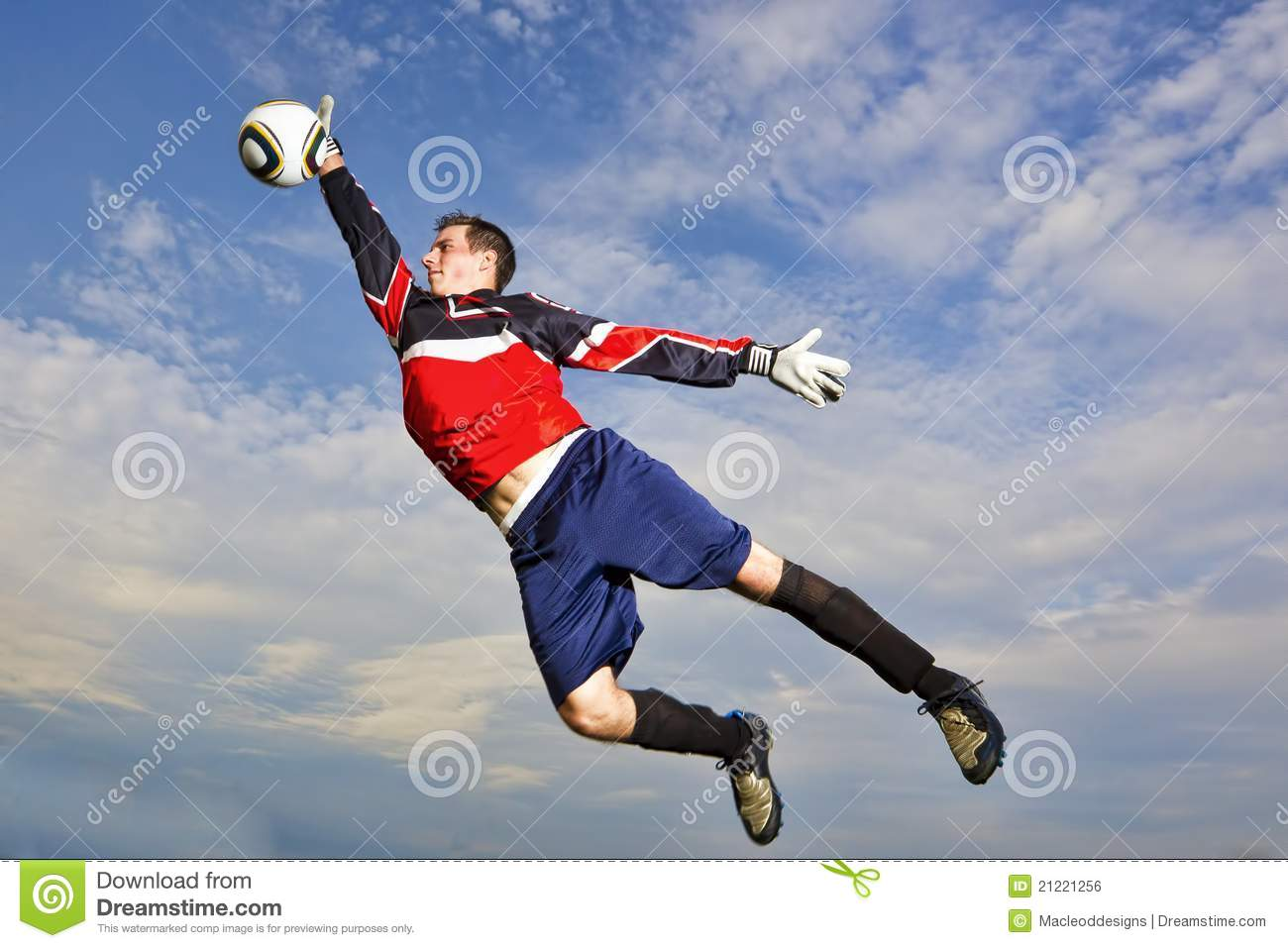 goalie jumps to catch soccer ball royalty free stock image