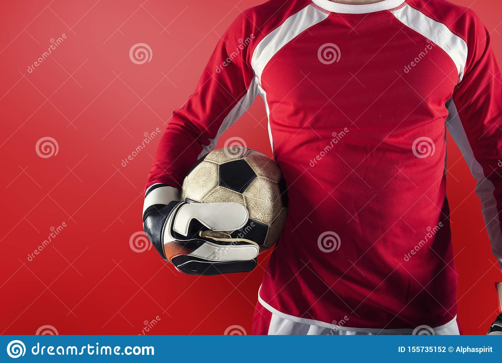Goalkeeper ready to play with ball in his hands