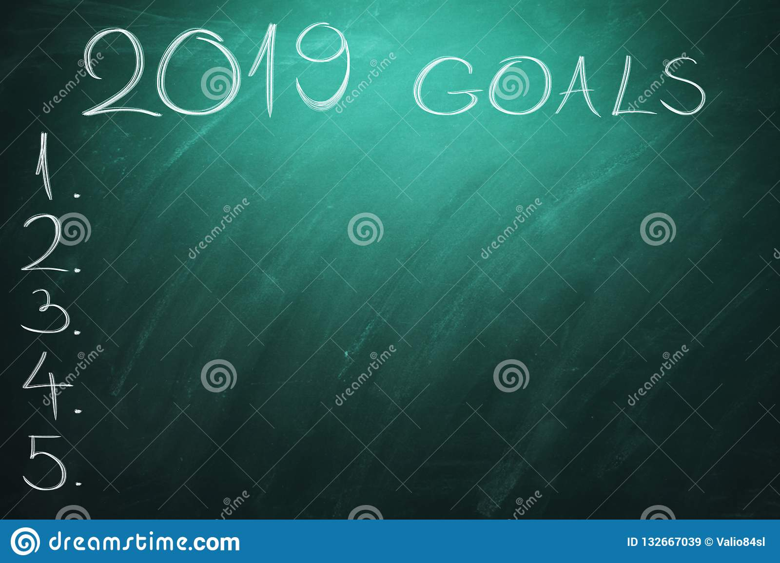 2019 Goals on green board. Chalkboard. New year - new business challenges.