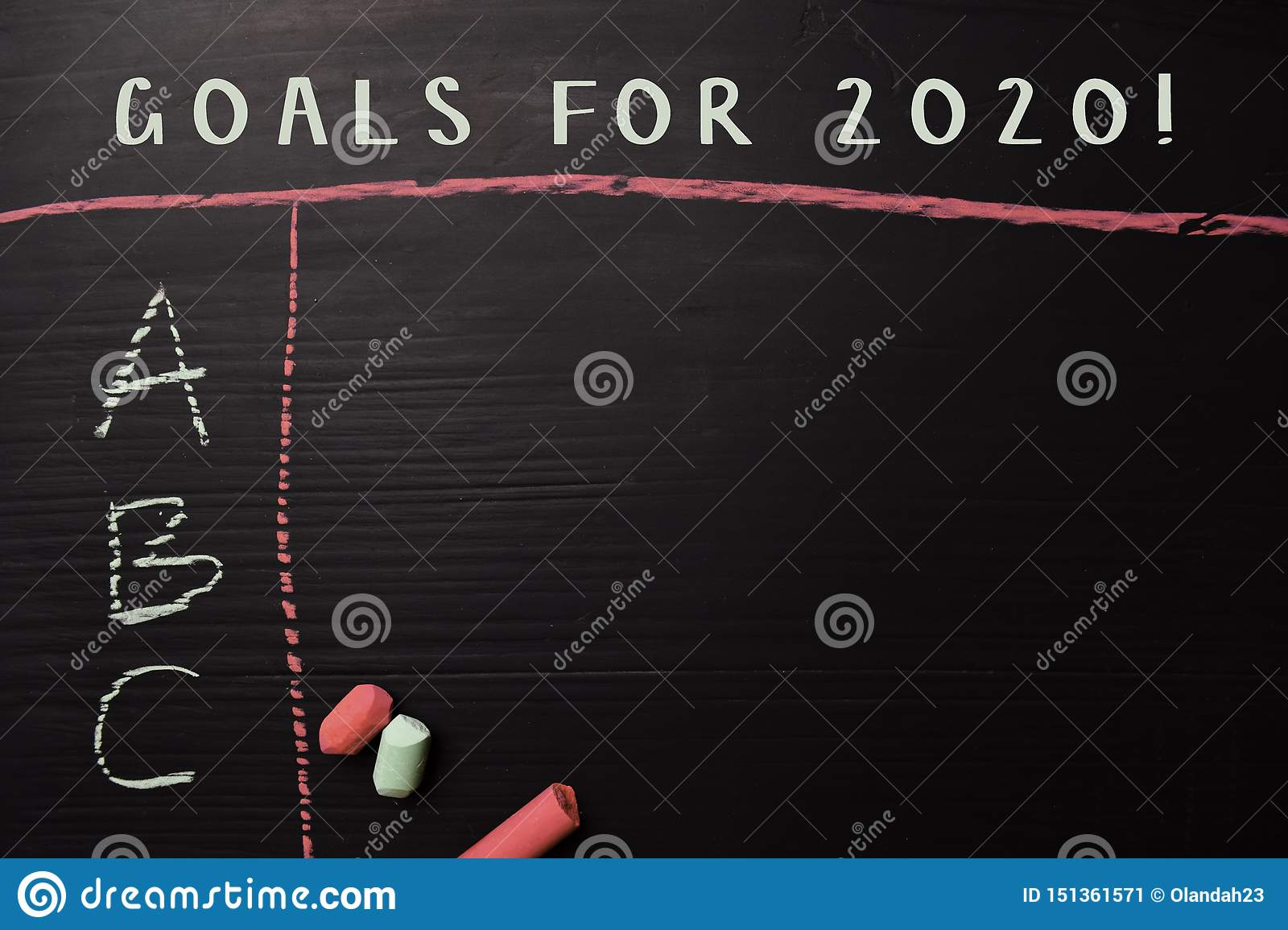 Goals For 2020! written with color chalk. Supported by an additional services. Blackboard concept
