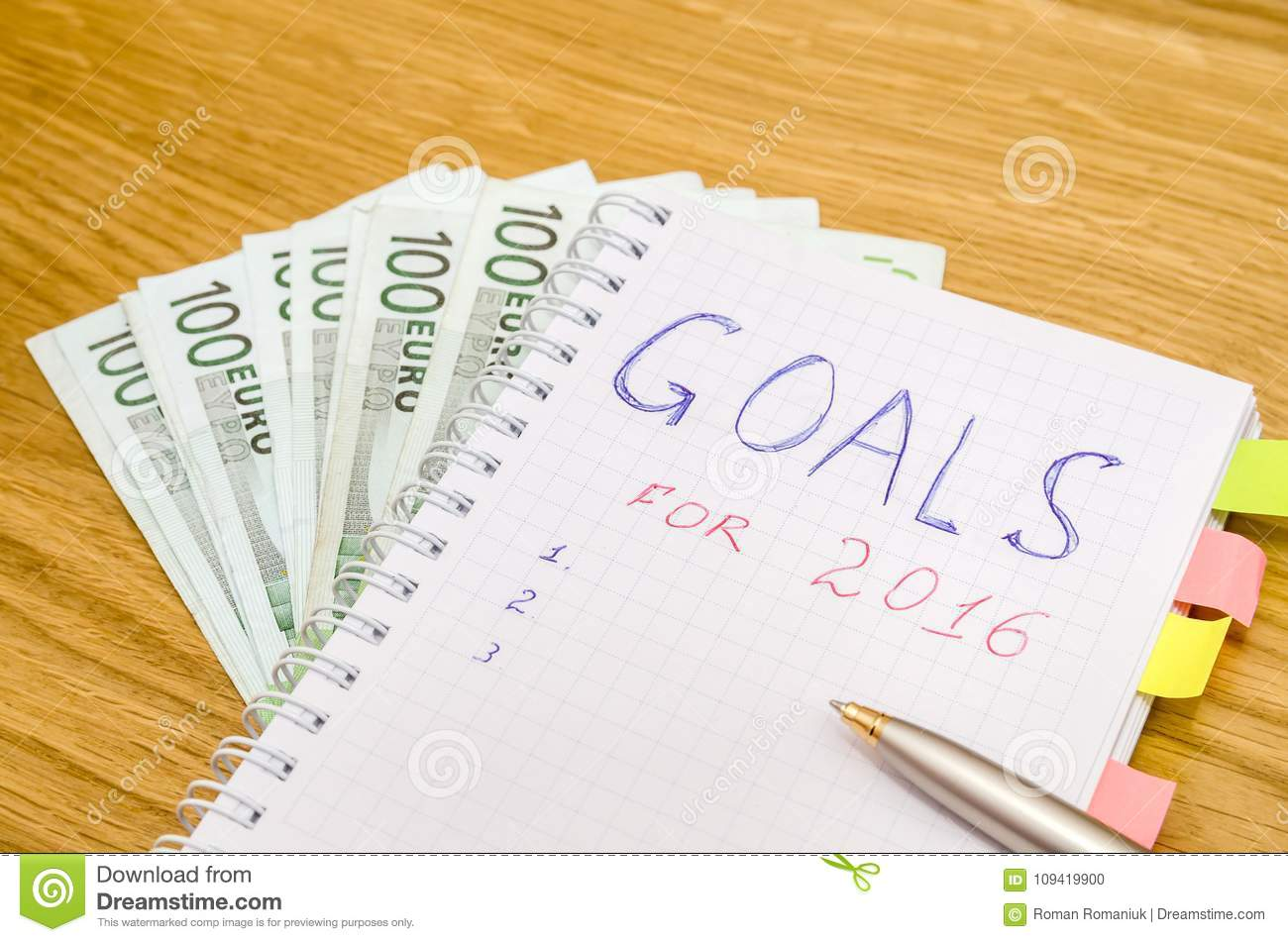 goals of year 2016 write on notebook with pen and euro