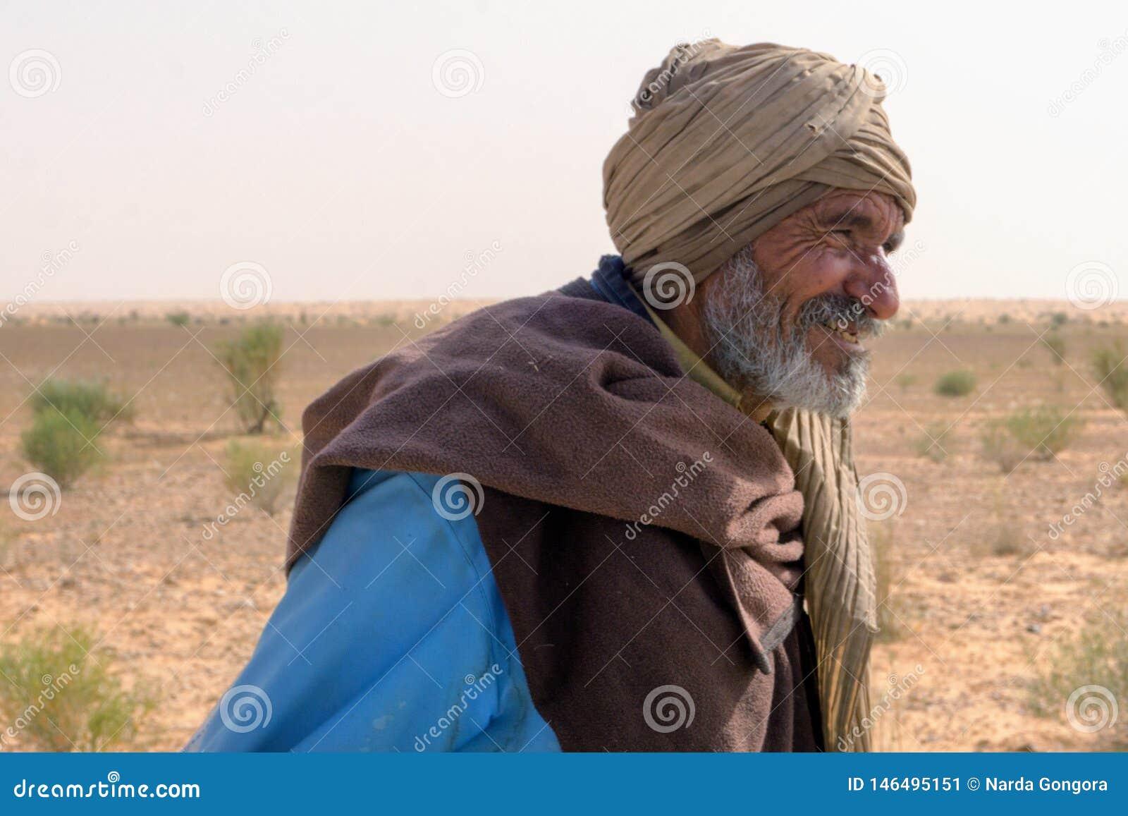 Goat Herder Smiles in the Sahara Desert in Tunisia