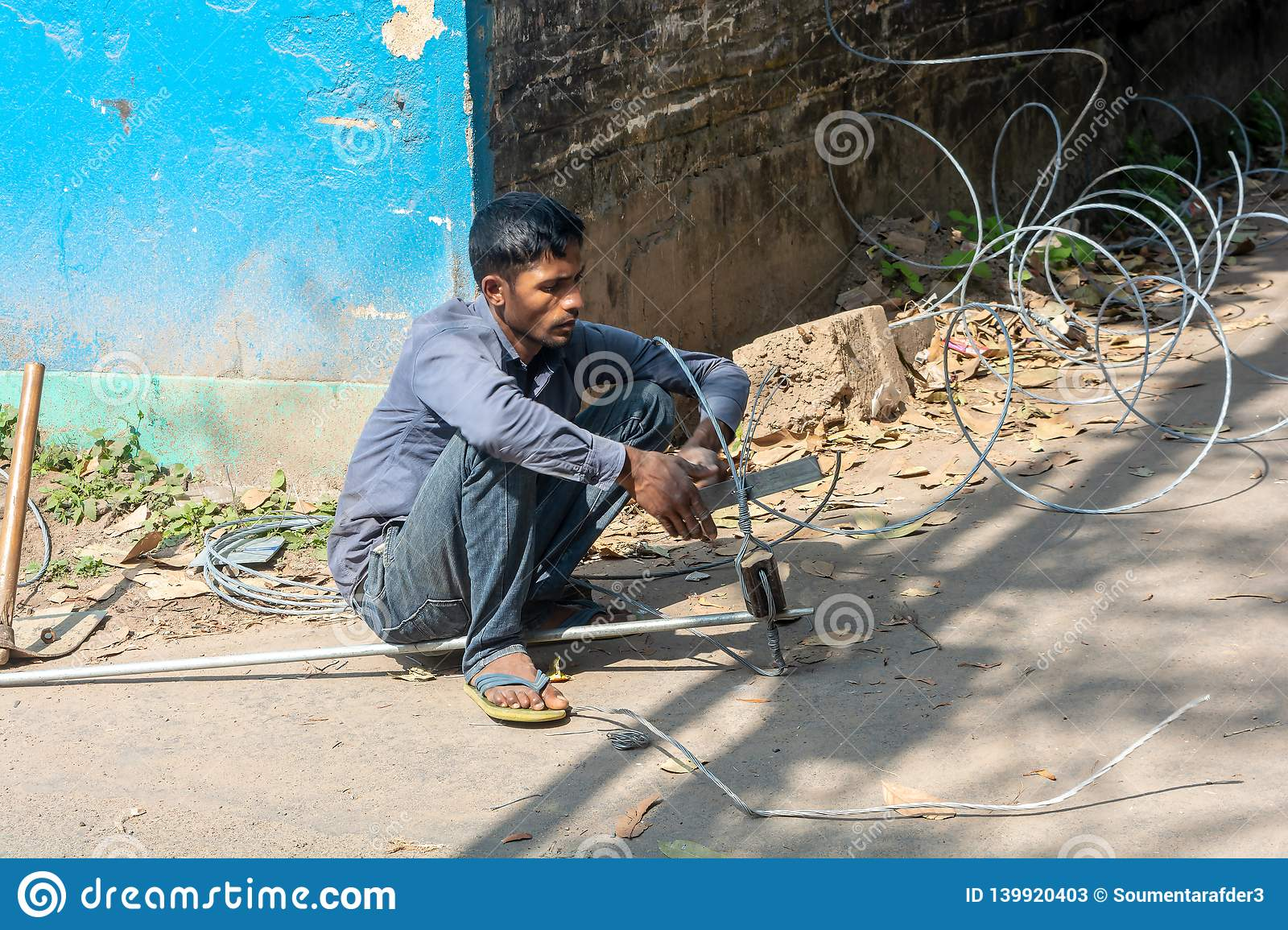 Man working with electrical wires without wearing safety gears